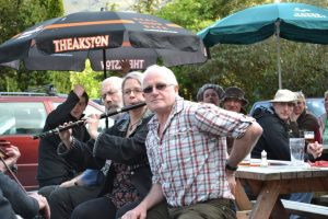 Laid-back tunes outside the Old Dungeon Ghyll Hotel at Langdale Festival